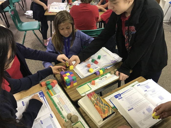 In math today, the 6th grade class explored volume by creating rectangular prisms and finding the volume of their prism.