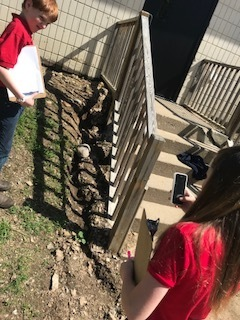 Using technology to take a picture of erosion.